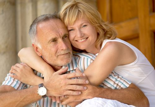 Woman embracing man. A stroke survivor and caregiver | Stroke Recovery Foundation
